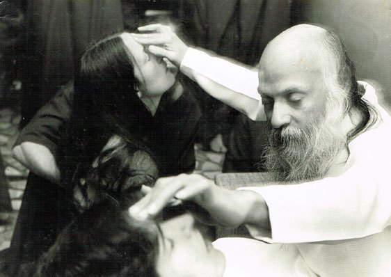 Osho giving energy to third eye